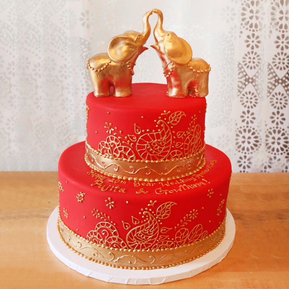 Свадебный торт с золотыми слониками
