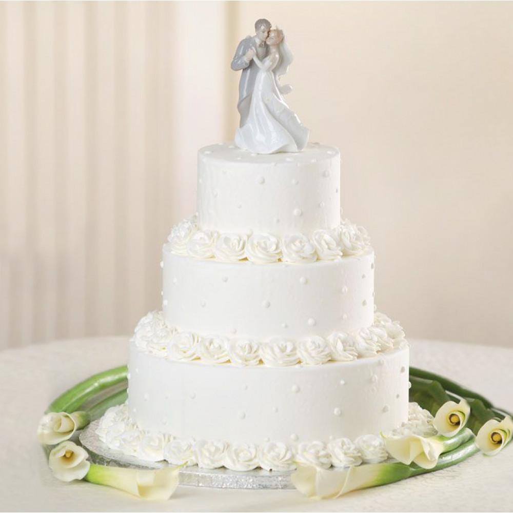 Многоярусный торт со свадебным топпером
