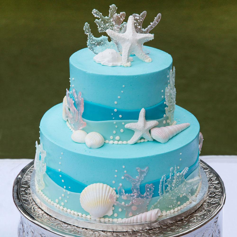 Голубой свадебный торт в морской тематике